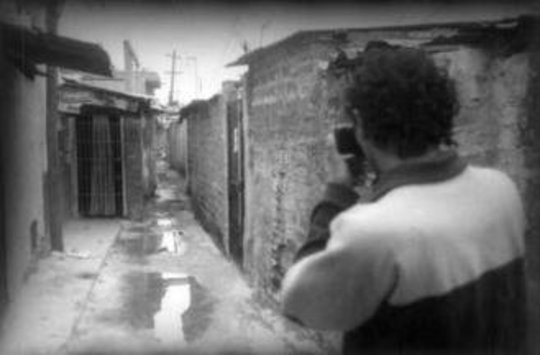 Angel taking photographs of the passageways of his