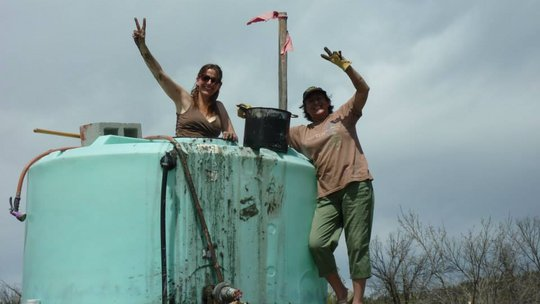 Uma and Jamie cleaning out the water tank