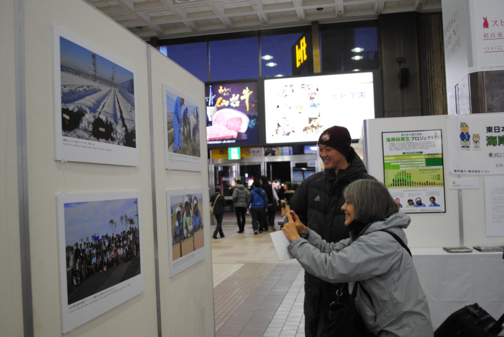 During the panel exhibition at Sendai Station.