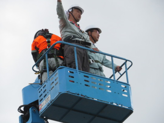 Mayor Yamada observing the project from above.