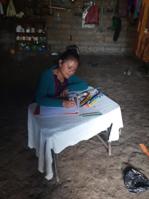 Scholar, Elena, studies at her house in Chajul.