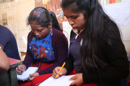 Two of our scholars working on homework