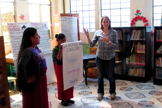 Greta conducting a workshop with the parents