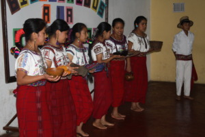 Scholars performing a folk dance during graduation