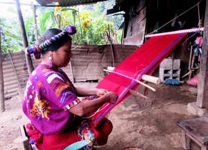 Maria supports her family by weaving