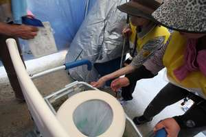 visually impaired participant examines a toilet