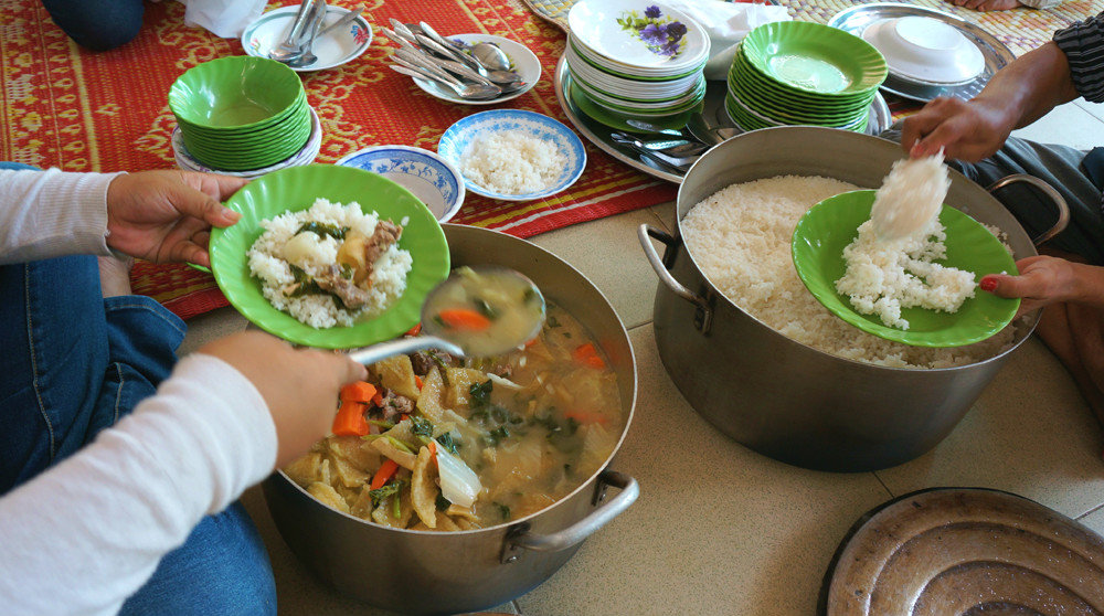 Housemothers serving meals to Riverkids children