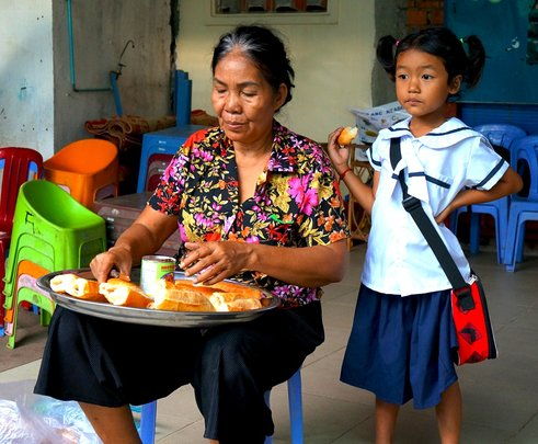 Housemother preparing breakfast for the children