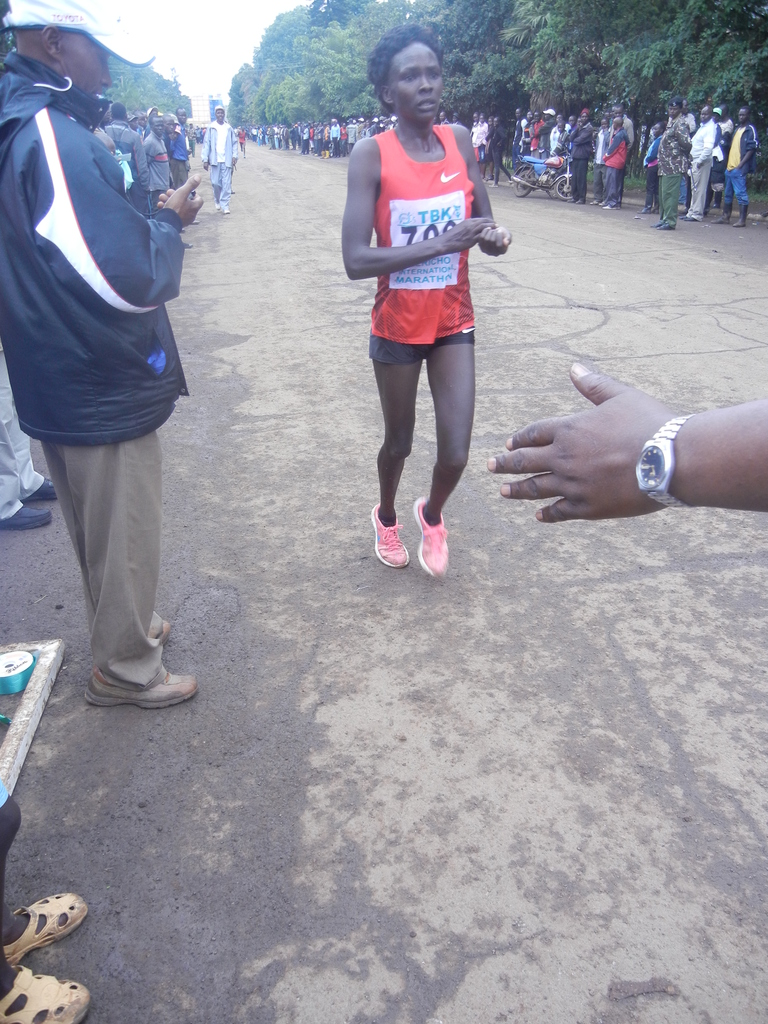 underprivileged runner at the finish