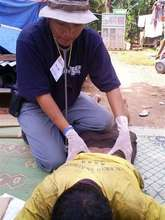 RI relief teams provide medical assistance to surv