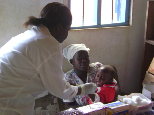 POSITIVE MOTHER AND HER BABY IN LAB FOR HIV TEST