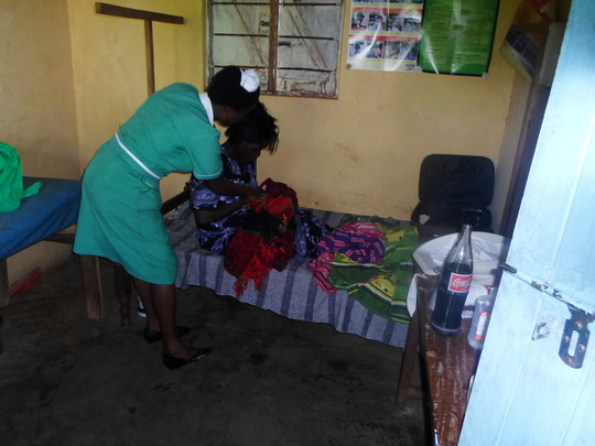 A HEALTH WORKER AFTER SAFE DELIVERY OF A MOTHER