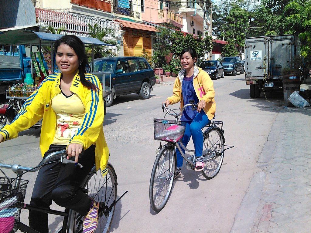 Mealea and friend bicycle through Banteay Meanchey