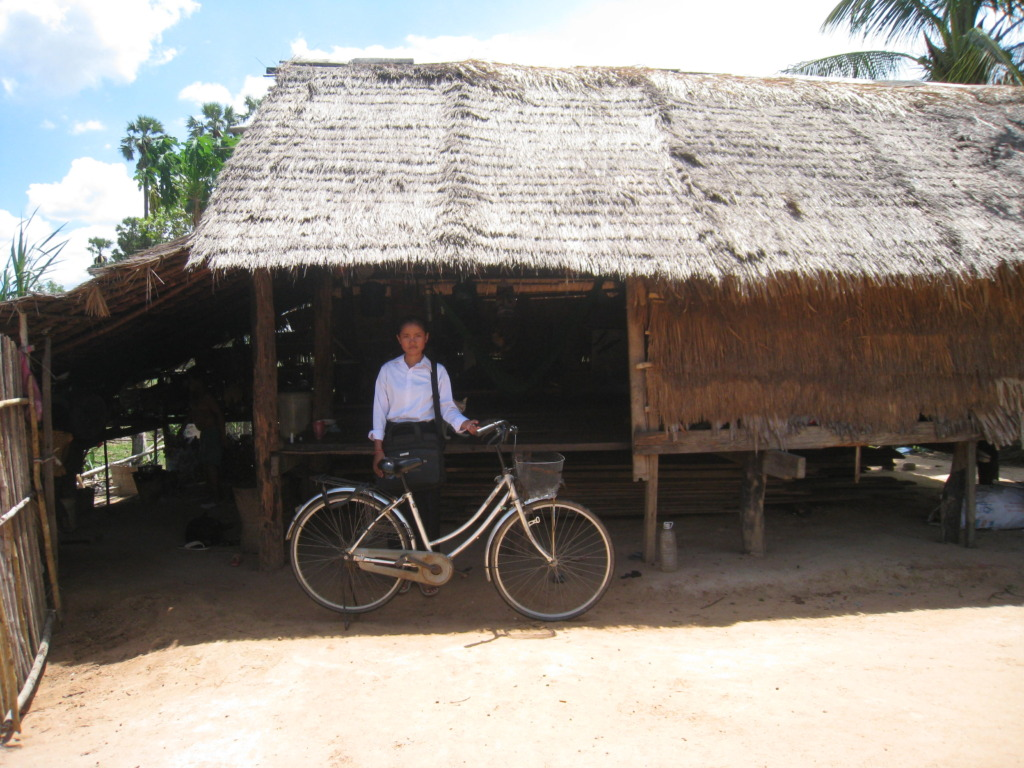 Daa in front of her house with her bike.