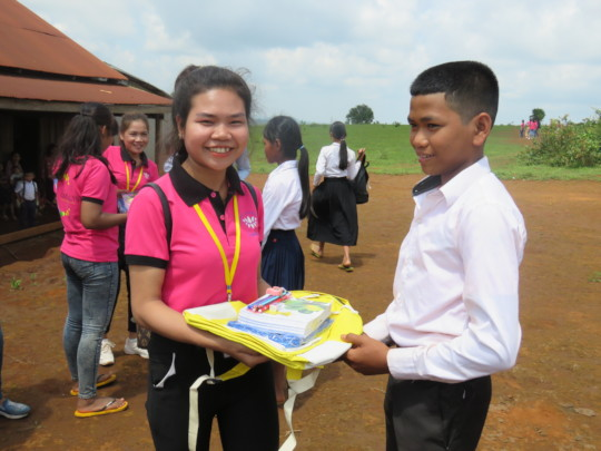 Sophin gives books during study visit