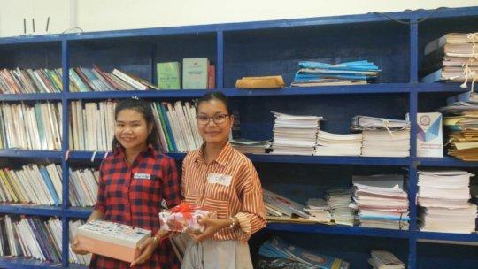 Sophin (left) receives gift for journal writing!