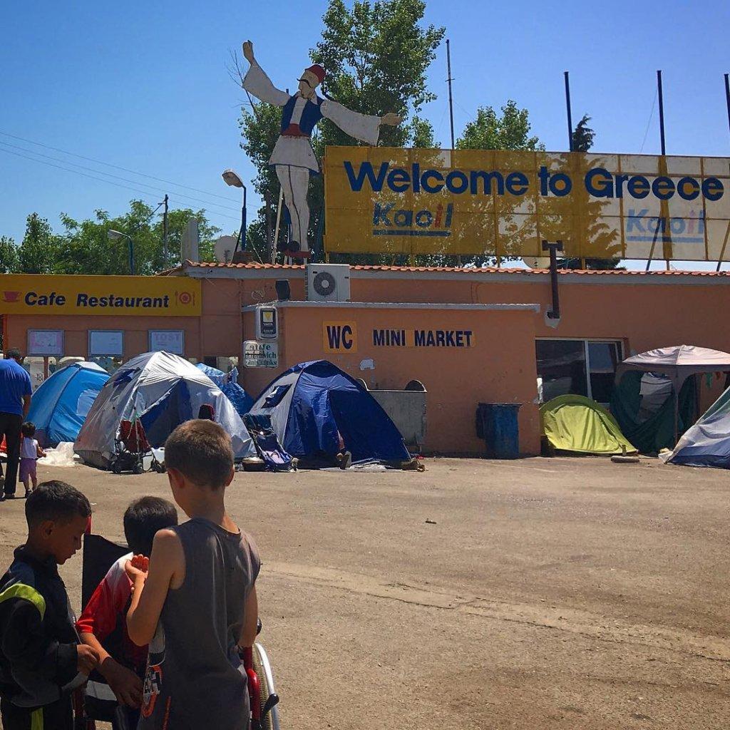 Informal refugee camp at a gas station in Greece