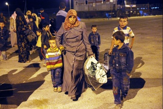 Family Traveling to Refugee Camp