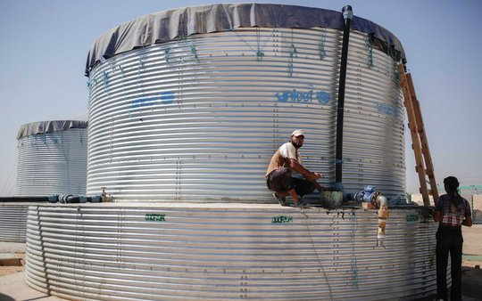 Water tanks, photo courtesy of Oxfam America