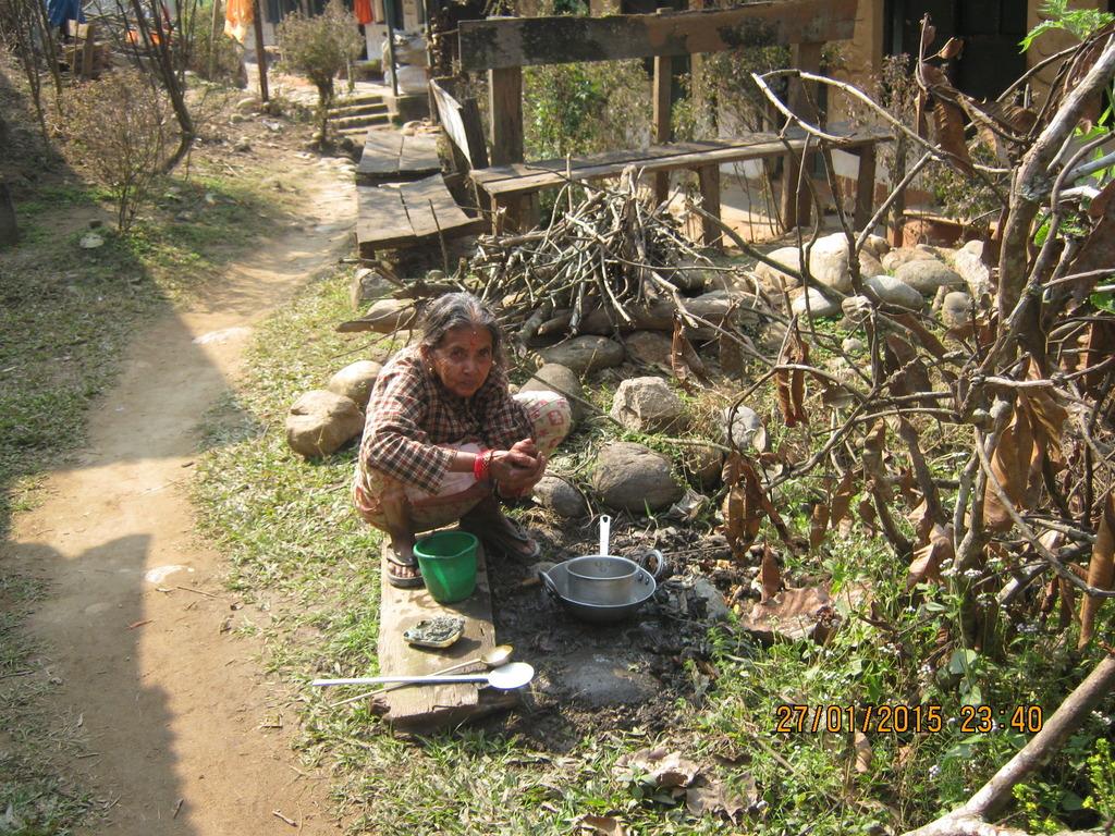An  woman washing  dishes at Manakamana