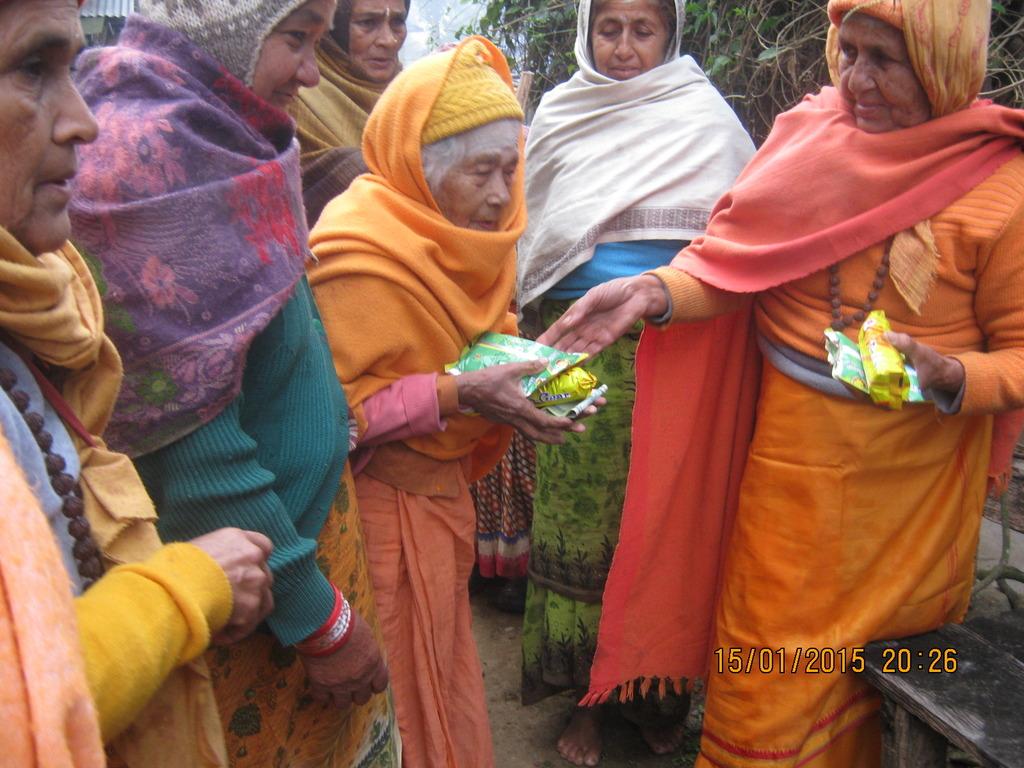 The women receiving gifts.