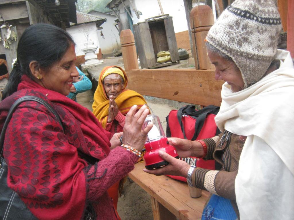 An old age woman receiving an lantern