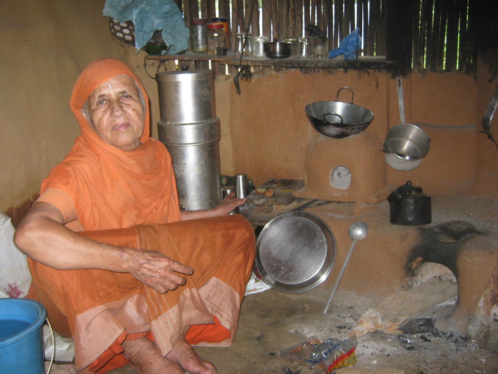 A holy women in  her kitchen room