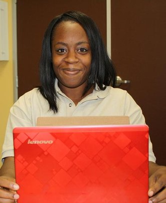 Domineisha receives a laptop from Microsoft