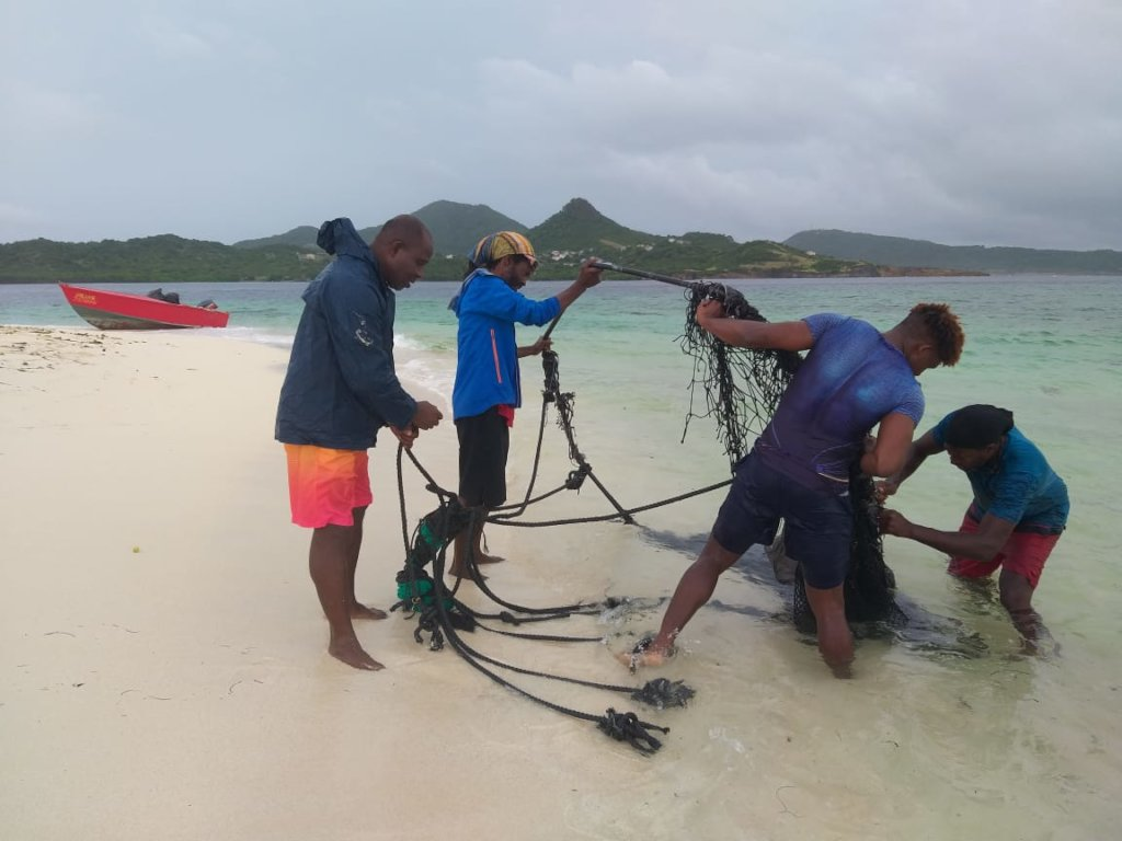 Removing a fish trap. Photo: Davon Baker