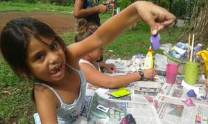 children making things with recycling materials