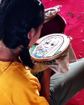 A participant and her beautiful embroidery