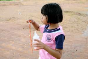 Blowing bubbles at Koung Jor refugee camp