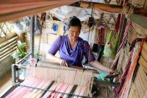 Camp residents earn a steady income by weaving
