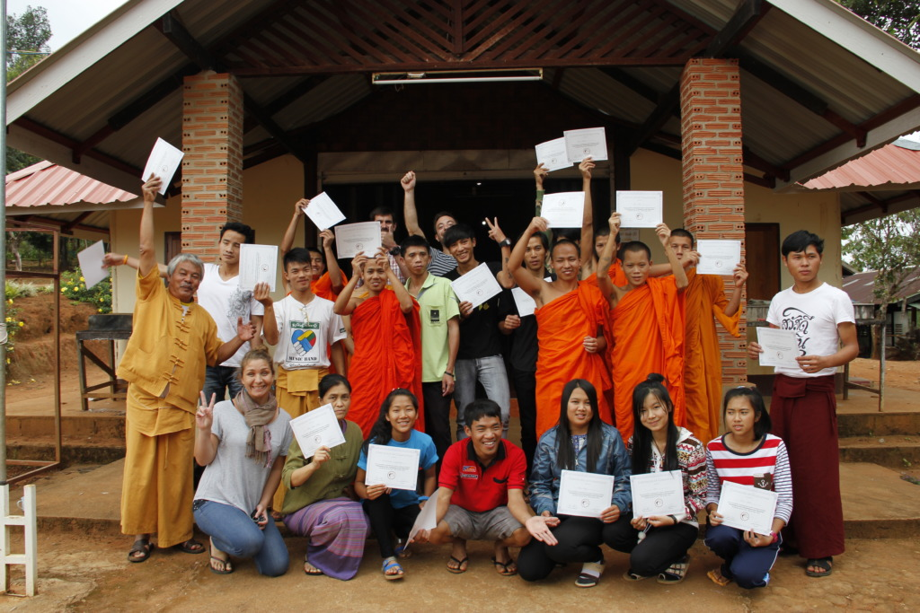 Teachers receive their certificates after training
