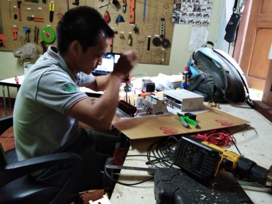 A Solbakken technician working on solar equipment