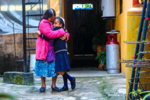 Flor and Her Grandmother At Their Home