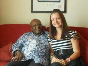 YJI student with Desmond Tutu