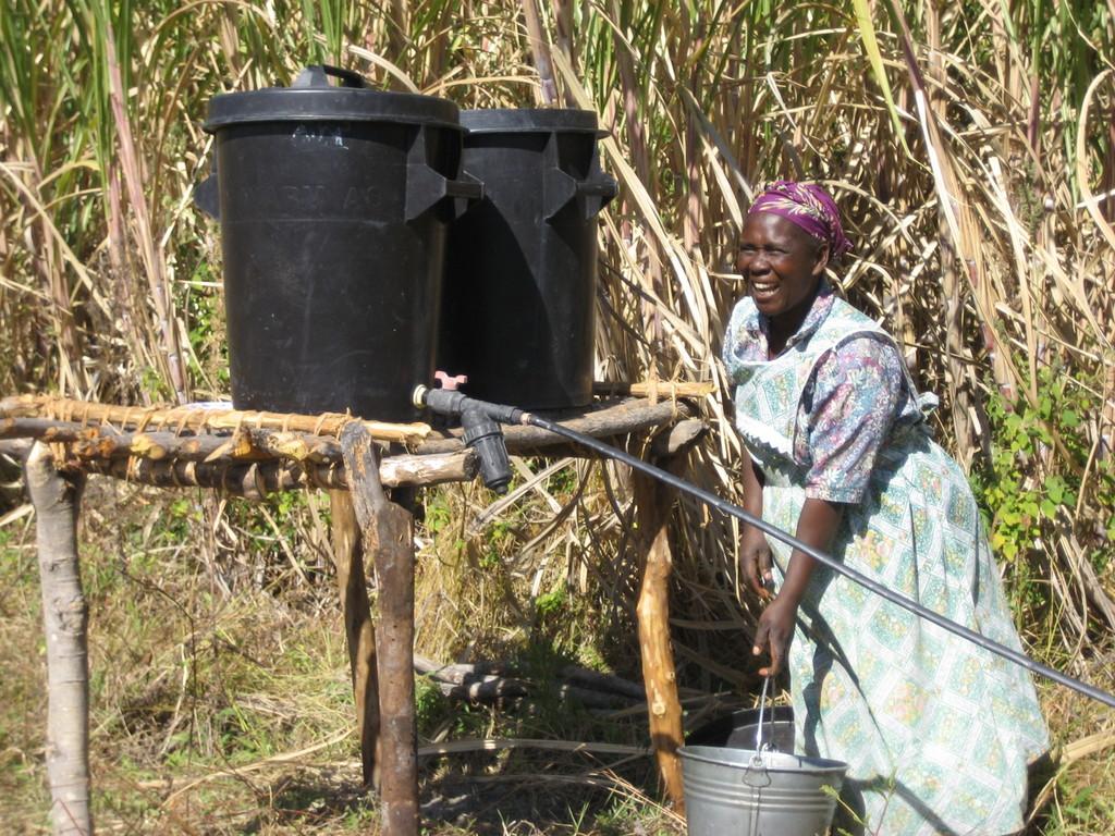 Granny fills her drip irrigation kit