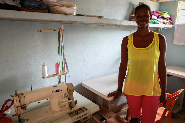 Gina in her sewing room -2nd round loan grantee!