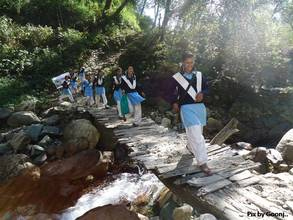 School girls walking on a newly constructed bridge
