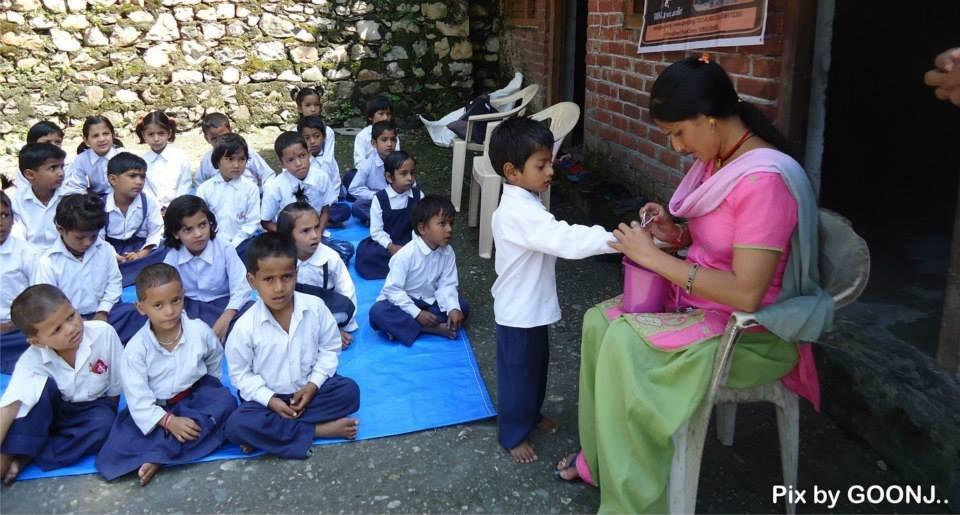 Teacher ensuring hygiene of the children