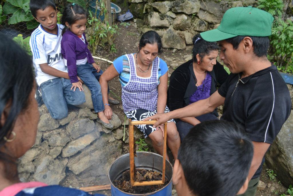 Genaro training beekeepers in Huehuetenango