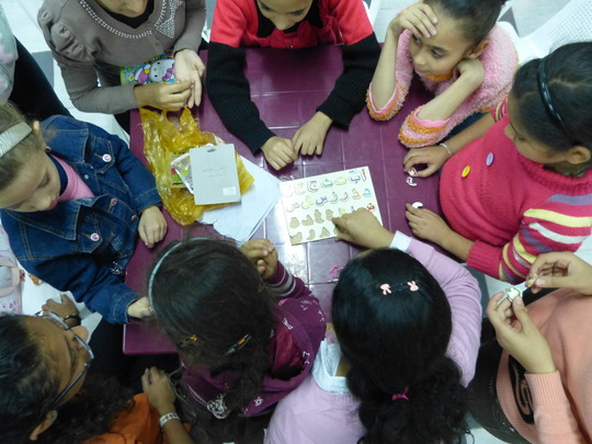 Little Sisters go over their Arabic lesson
