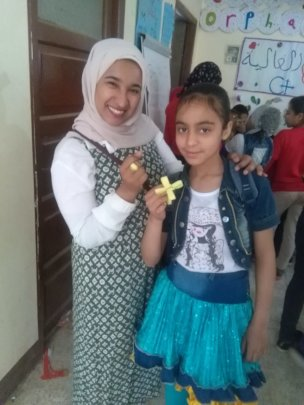 Valuable girl sisters make Palm Sunday crafts