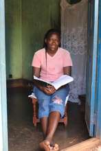 Christine at home. Her issue is school dropouts