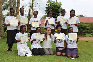 Girls with well earned graduation certificates
