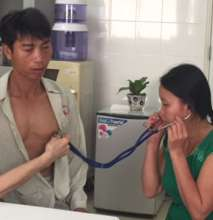Vinh's wife listens to his heart pre-surgery