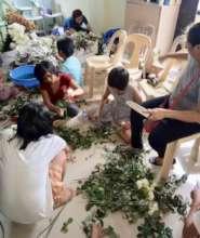 Tahanan's girls enjoy arranging flowers