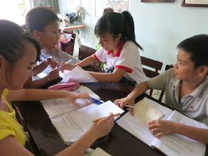 a tutor spends quality time helping students