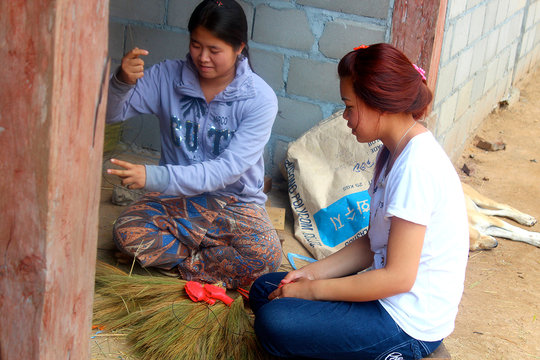 Khantin and Duangmany earn income selling brooms.
